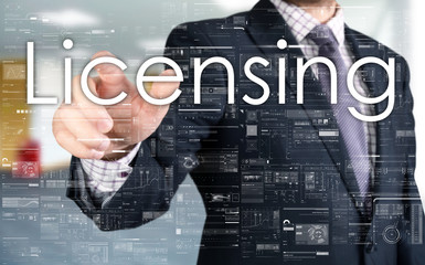 the businessman is choosing Licensing from touch screen