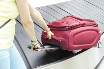 Luggage in airport conveyor belt