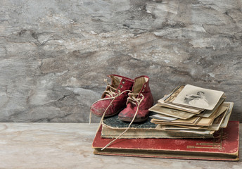 Antique books, photos, and baby shoes. Nostalgic still life
