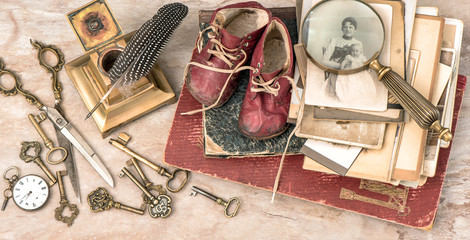 Antique books and photos, keys, baby shoes and writing accessori