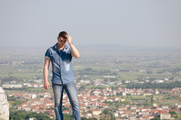 Man's portrait , small city as background