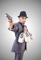 Businessman criminal with sacks of money