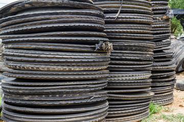 Stack of old wheel black tyre.