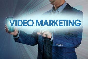 Businessman presses button video marketing on virtual screens. B