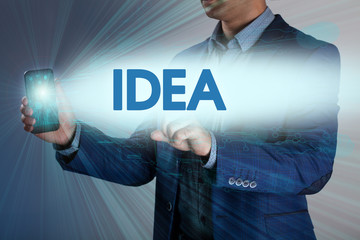 Businessman presses button idea on virtual screens. Business, te