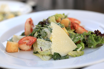 Plate of Caesar salad with shrimps
