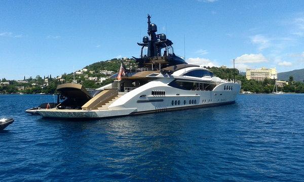 silver grey power motor super yacht at sea