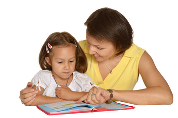 Mother doing homework with  daughter