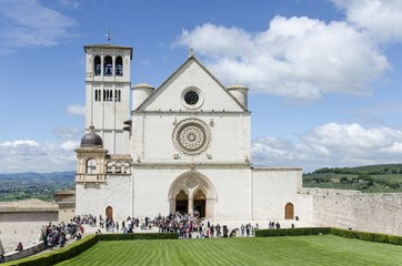 Tourists visit the basilica of St. Francis of Assisi, Umbria, Italy
