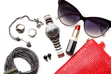 Wall Mural - Overhead fashion female accessories watch sunglasses red purse.