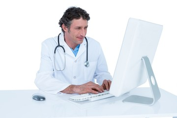 Smiling doctor working on his laptop