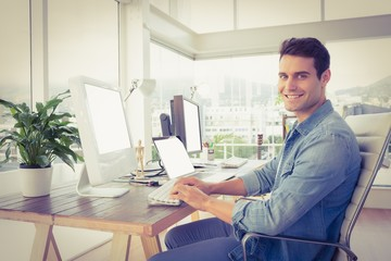 Casual businessman using computer in office