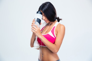 Fitness woman holding bottle with water