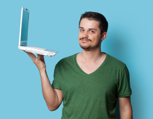 guy in t-shirt with laptop computer