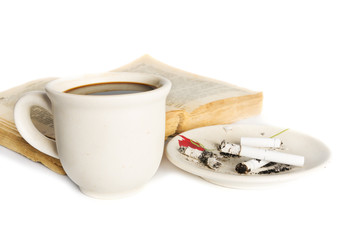 Coffee cup with book and cigarettes