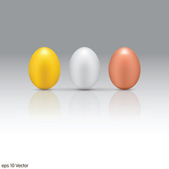 Gold, Silver, Bronze eggs on a white background.