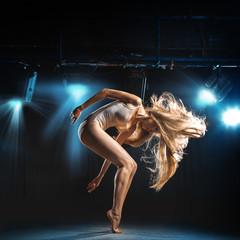 portrait of ballet dancer in pose on stage