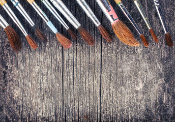 brushes for painting on  wooden  background