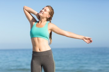 Beautiful fit woman stretching her neck