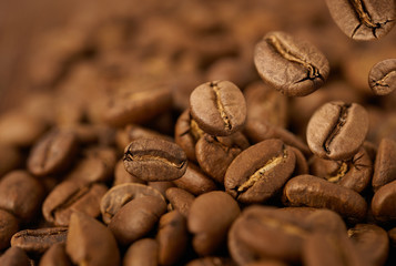 Closeup of coffee beans with focus on one