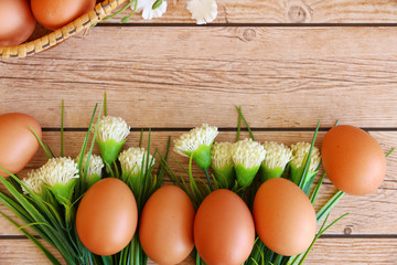 Eggs in the basket on wooden background