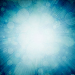 bright white sunburst design on teal blue sunburst pattern background with white bokeh lights, zoomed in effect border