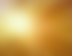 abstract bright shiny gold blurred background colors in soft blended design