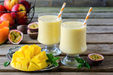Tropical mango and passion fruit smoothie for healthy breakfast