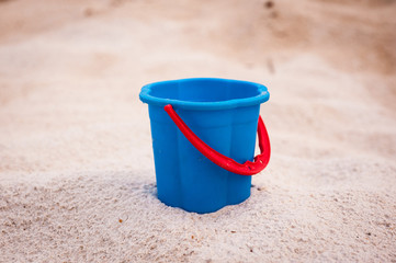 blue bucket with red handle