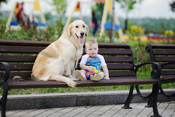 baby boy with a dog retriever