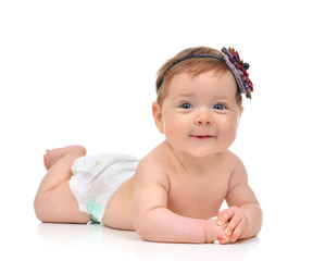 Four month Infant child baby girl in diaper lying happy smiling