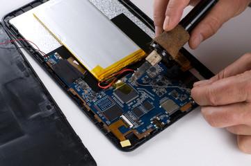 Repairman Soldering Electronic Device