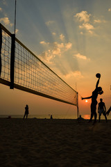 Fototapete - Beach volleyball silhouette at sunset , motion blurred