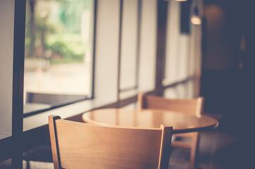 Empty table in coffee shop. Retro filter.