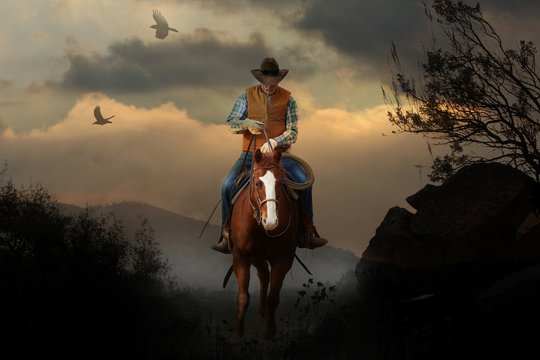 A mountain cowboy rides to the peak of a mountain with a beautiful cloudy sunset in the background with birds and crows flying above.