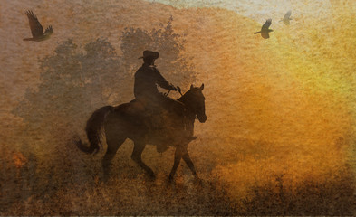 A dramatic design of a cowboy and his horse riding in a meadow into the sunset with crows flying above.  A mixed media piece of artwork in photography and watercolor.