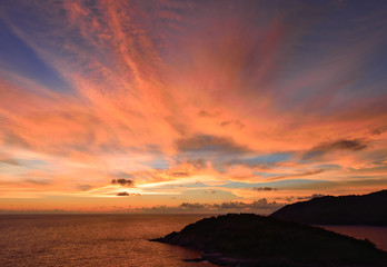 Sunset sky with pink clouds explosion after sunset on the ocean