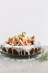 Fig topped sponge cake on a cooling rack