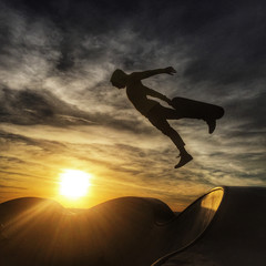 Silhouette of a man skateboarding