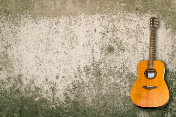 Acoustic Guitar and blank grunge background