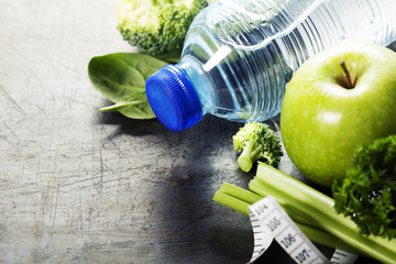 Fresh healthy vegetables, water and measuring tape. Health and d