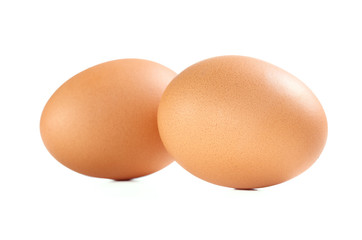 Two Brown Chicken Eggs Isolated on White Background.