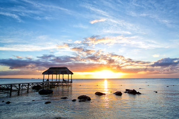 Wall Mural - Beautiful sunset with jetty in Mauritius Island
