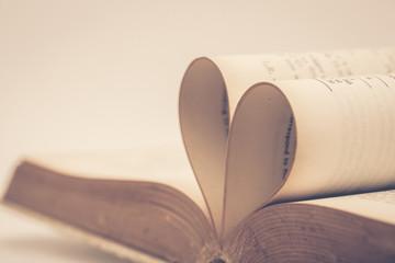 Valentine day background. Book made heart shape in vintage filter.