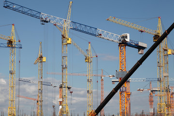 Construction cranes at building site
