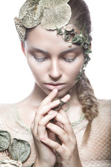 Beautiful fashionable girl in  image of sea fairies with shells