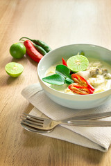 Spicy creamy coconut soup with chicken
