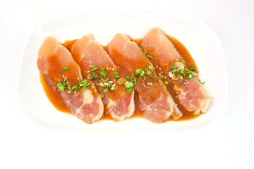 Fresh slices of chicken isoloate on white background ready to be