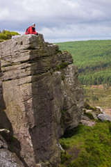 A hiker taking in Simonside Crag Views