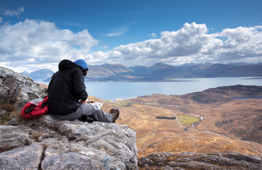 Hiker stops for lunch above Loch Linnhe